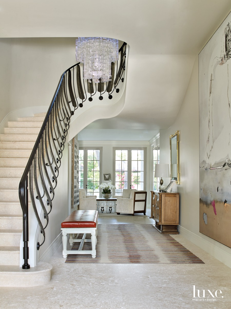 mediterranean foyer neutral and staircase