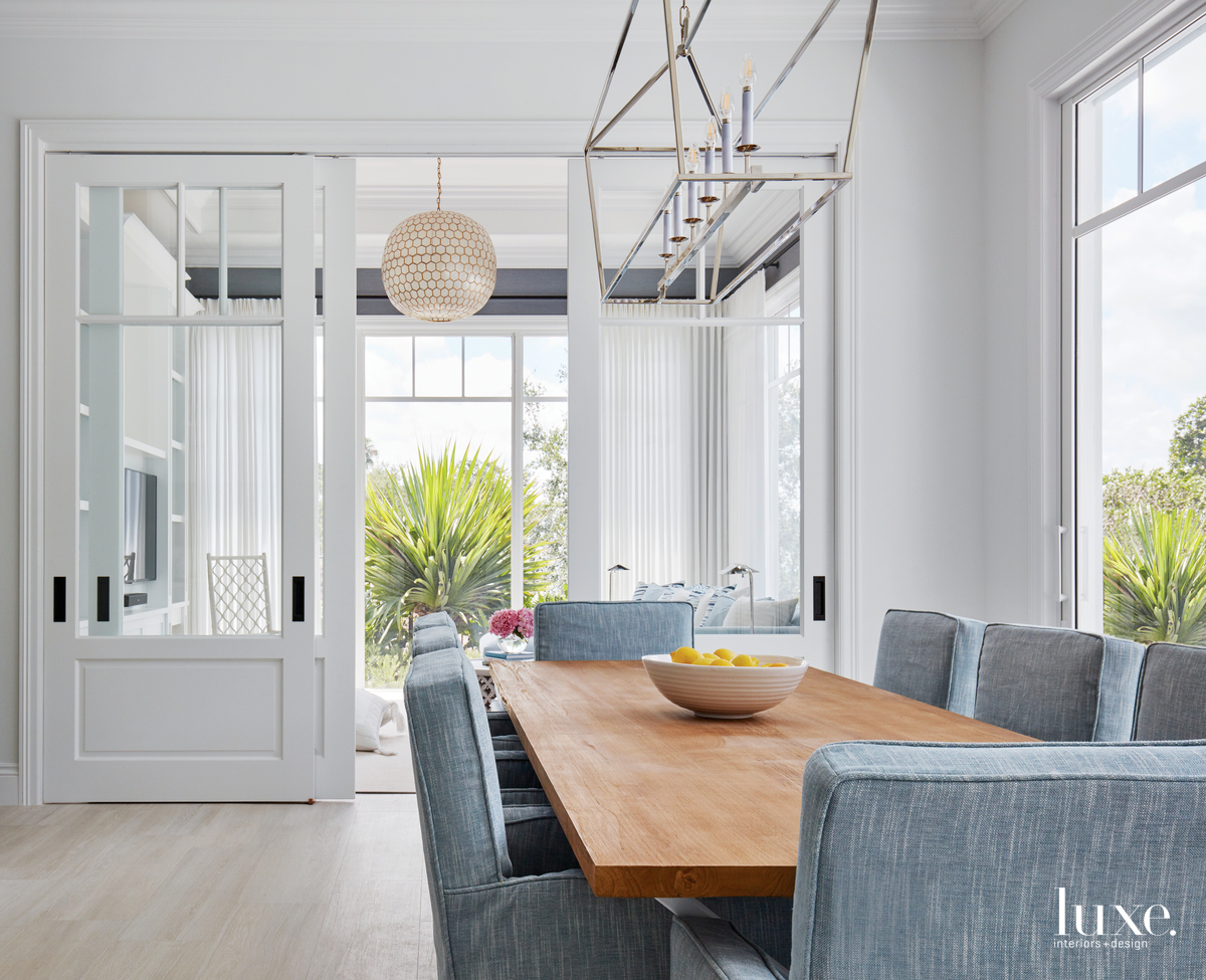 transitional white dining room pale...