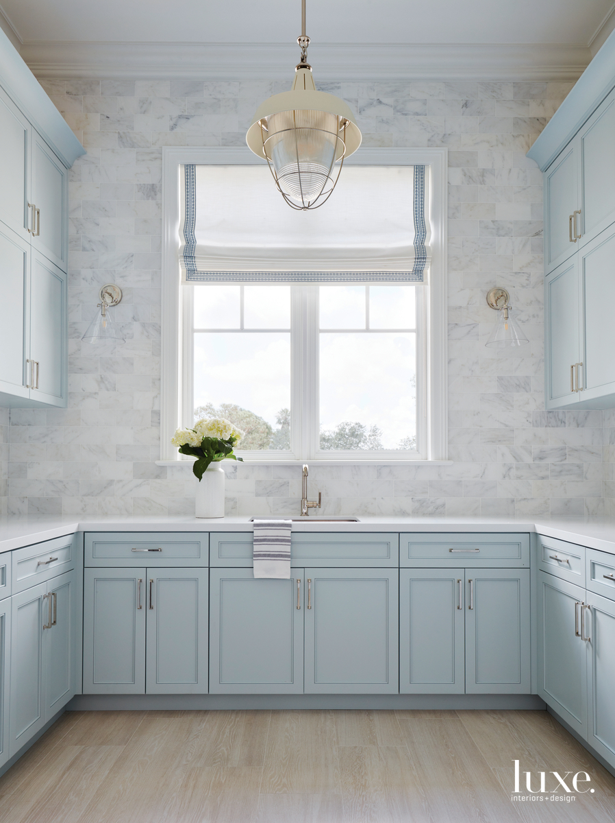 transitional laundry room pale blue...