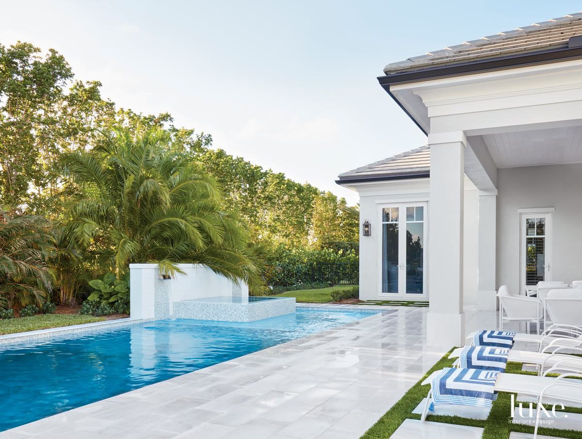 transitional exterior pool and sitting...