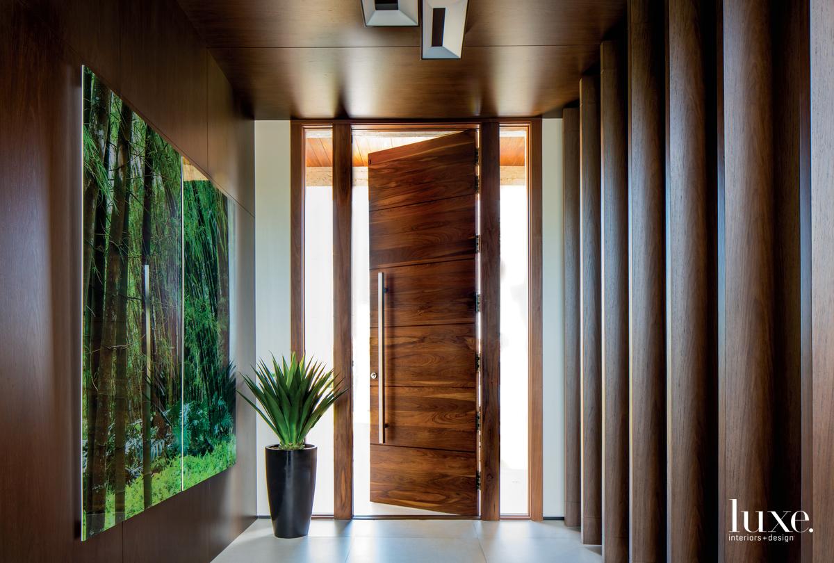 contemporary brown foyer ipe-wood door...