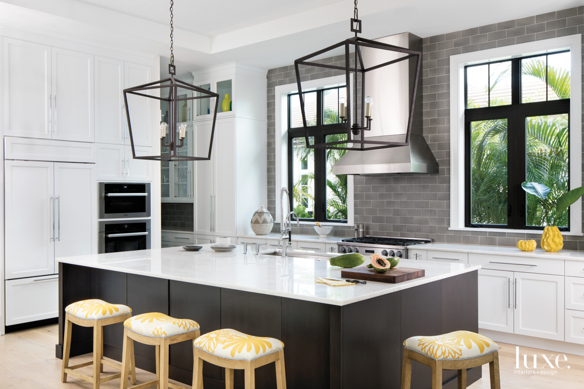 modern white kitchen black island...