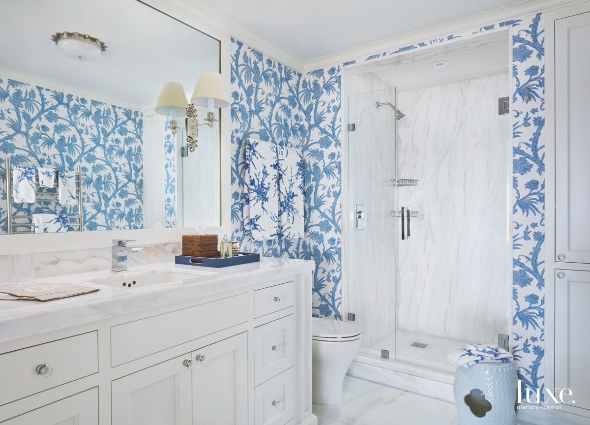 contemporary blue bathroom white cabinetry