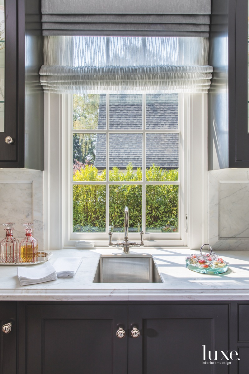 transitional kitchen pantry marble countertops...