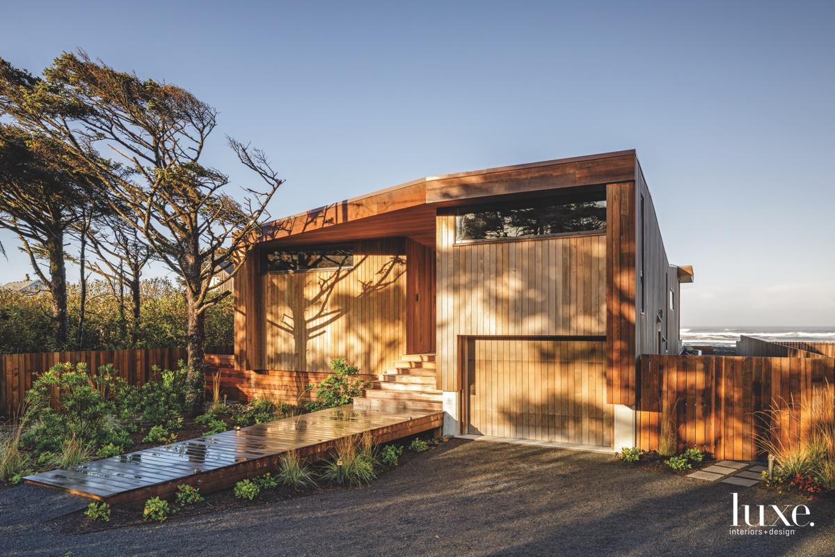 modern exterior vertical wood paneled...