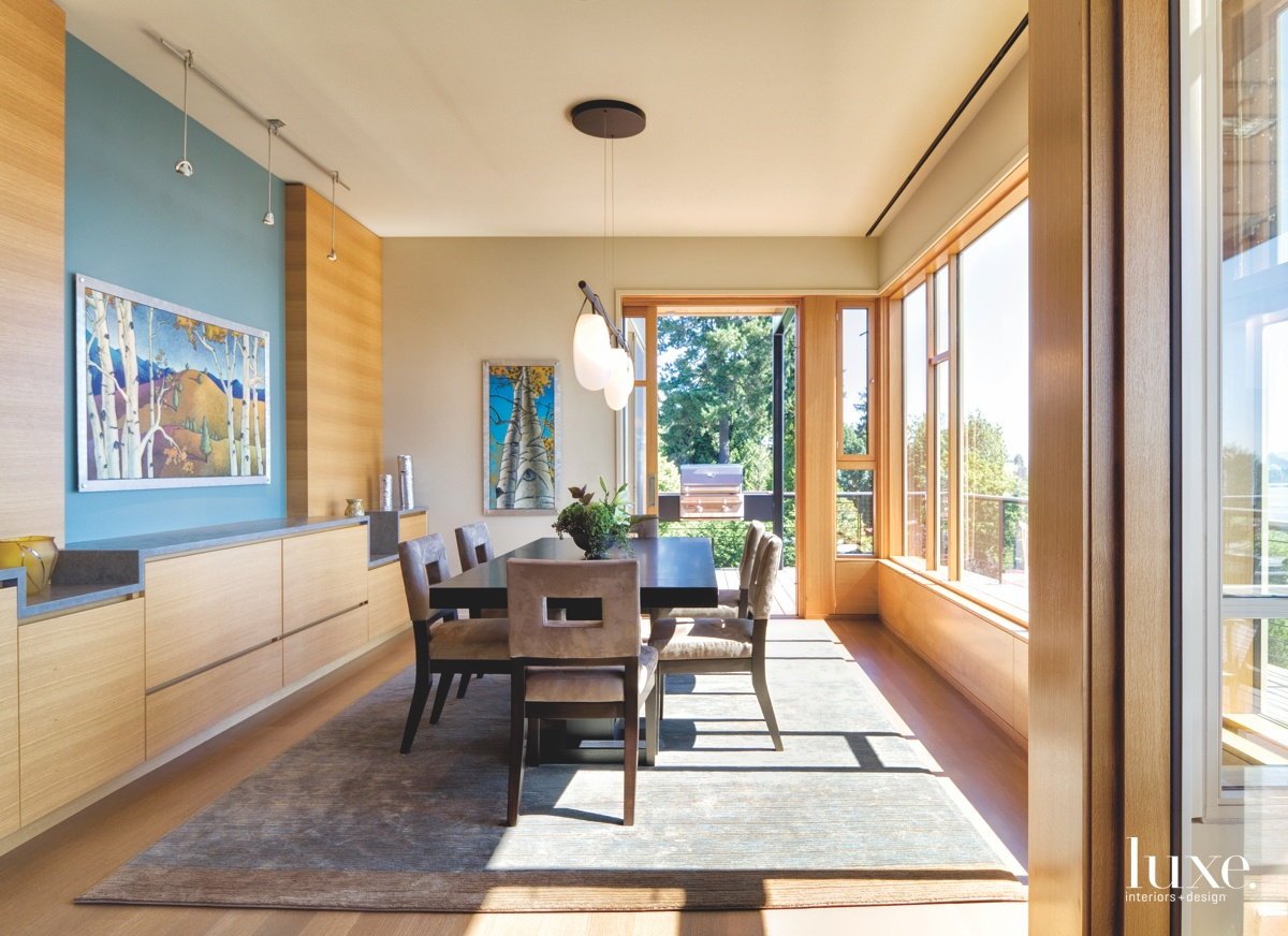 contemporary dining room expansive windows...