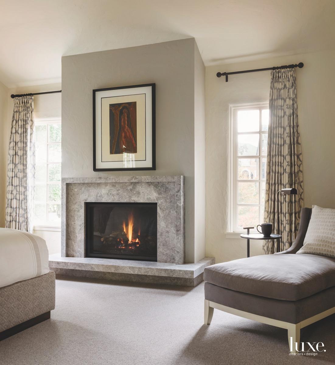 mediterranean neutral bedroom fireplace