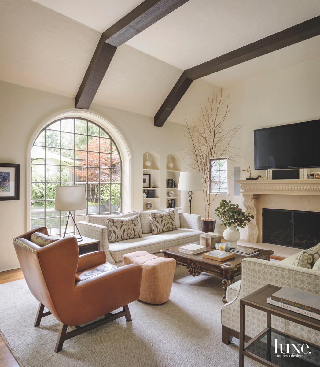 mediterranean living room orange chair...
