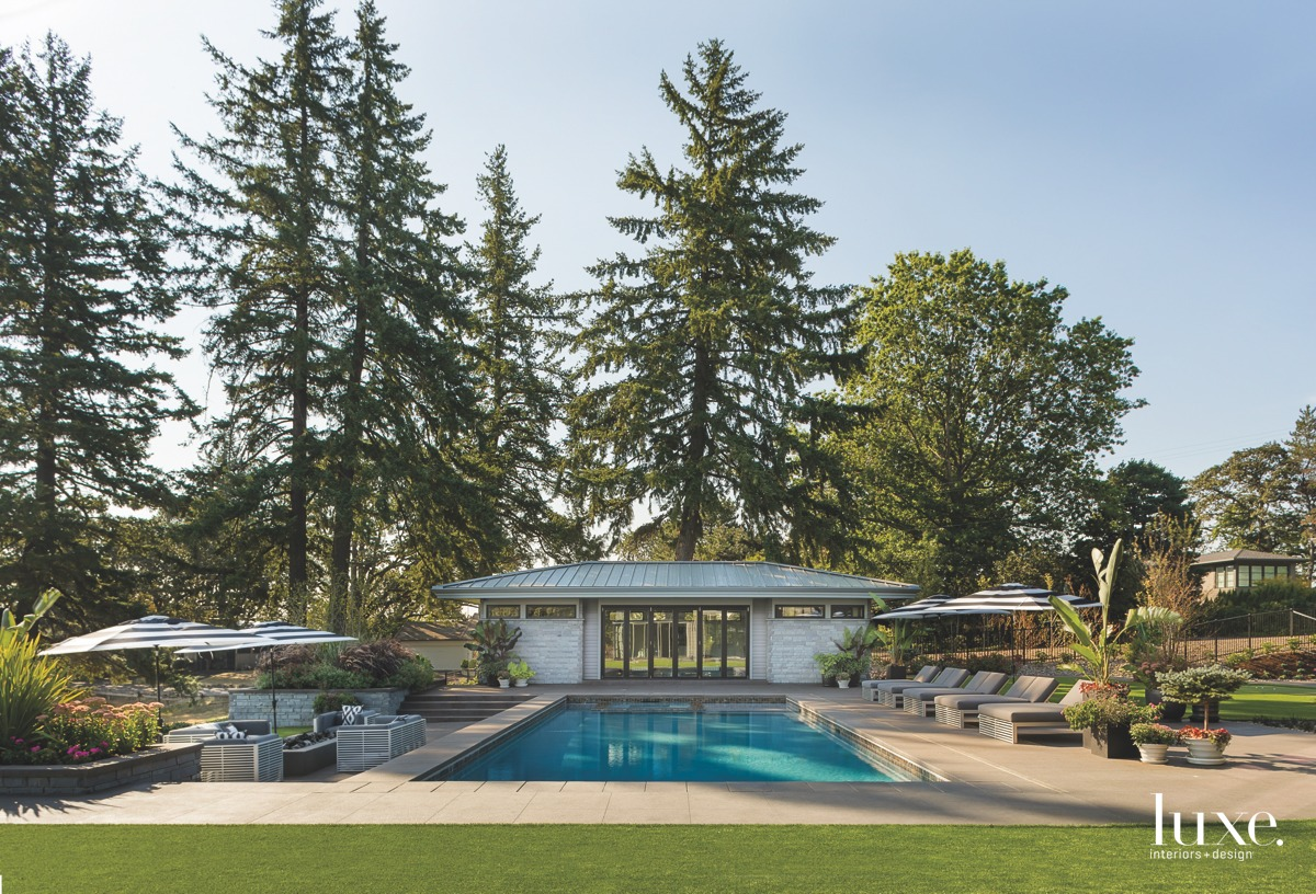 contemporary outdoor pool and guesthouse