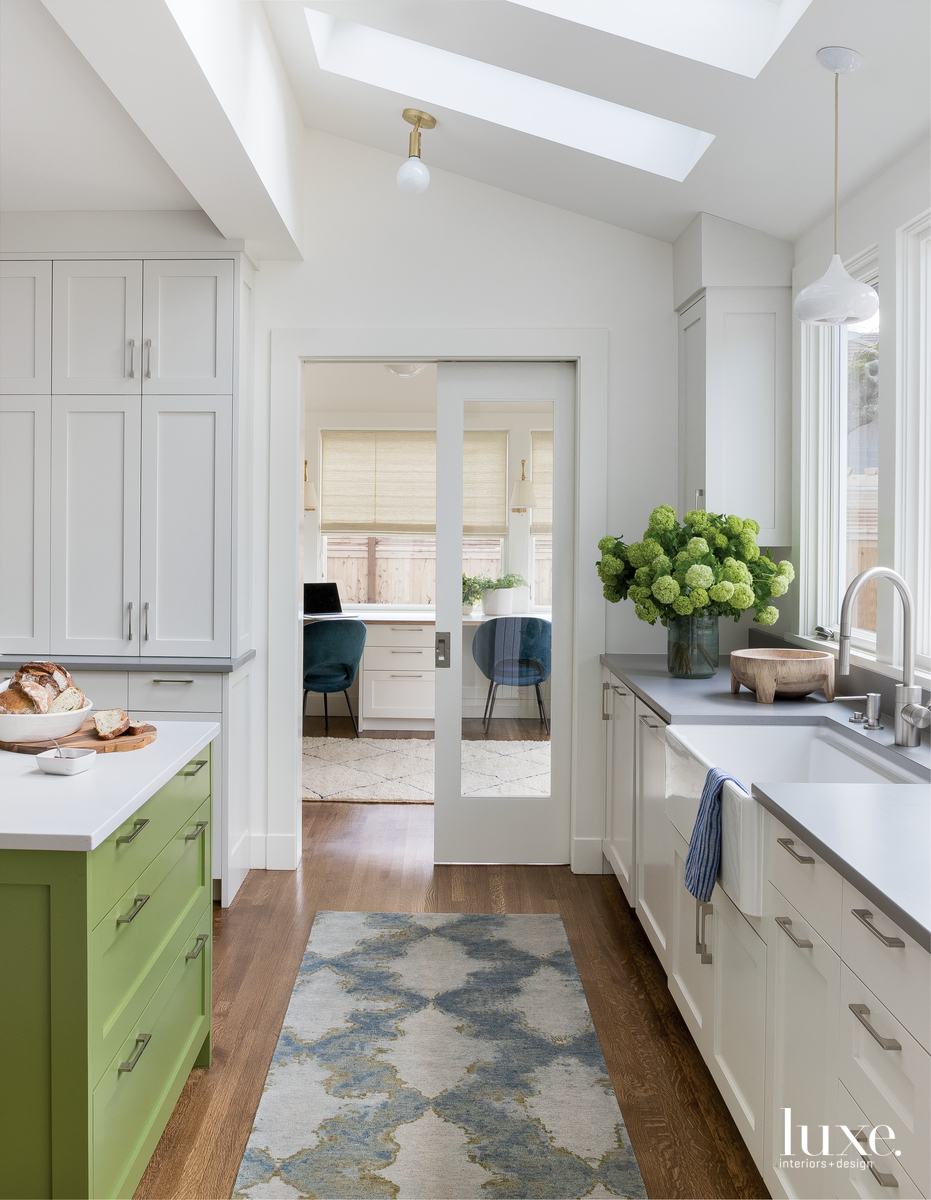 modern white kitchen green island