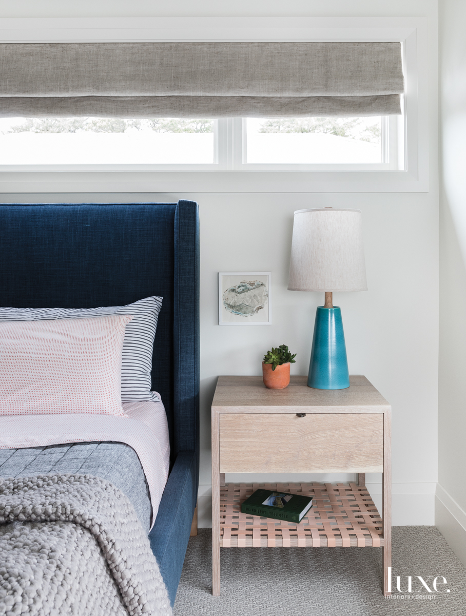 modern bedroom white walls blue...