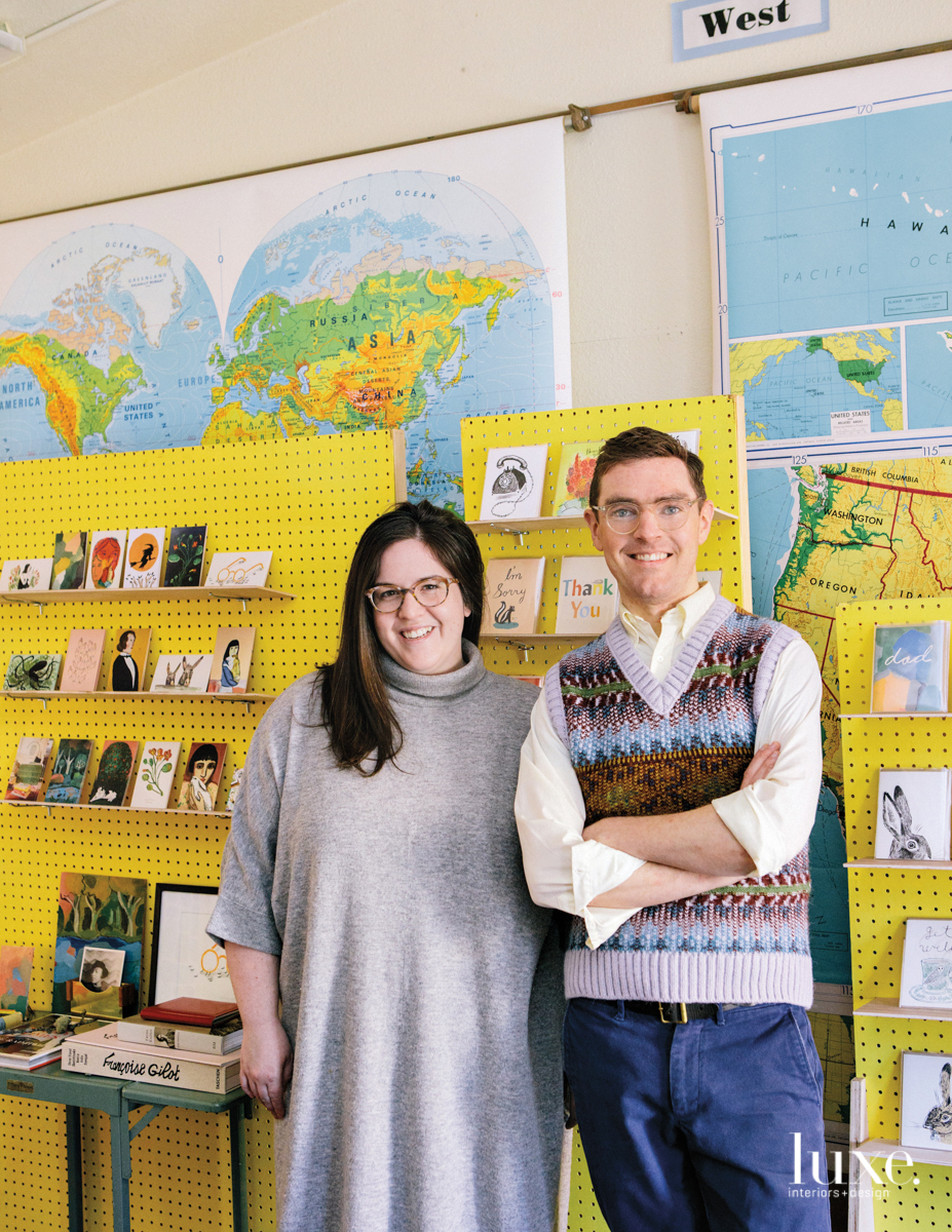In their Seattle studio, Wagner and Doyle stand in front of the card walls where they display their product line.