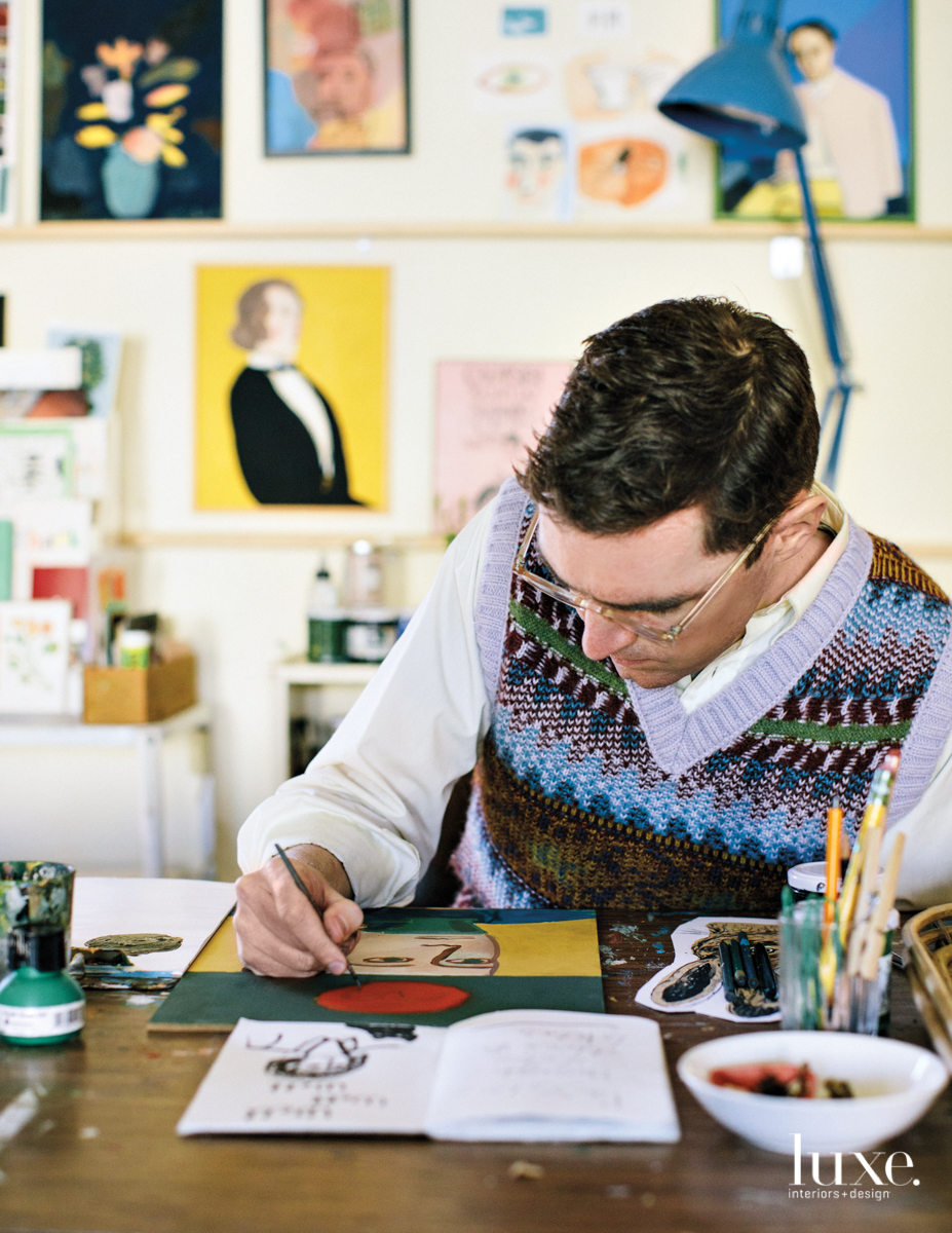 One part of the creative duo behind Seattle stationery company Apartment On Belmont, artist Michael Doyle works away on one of the company's whimsical designs.