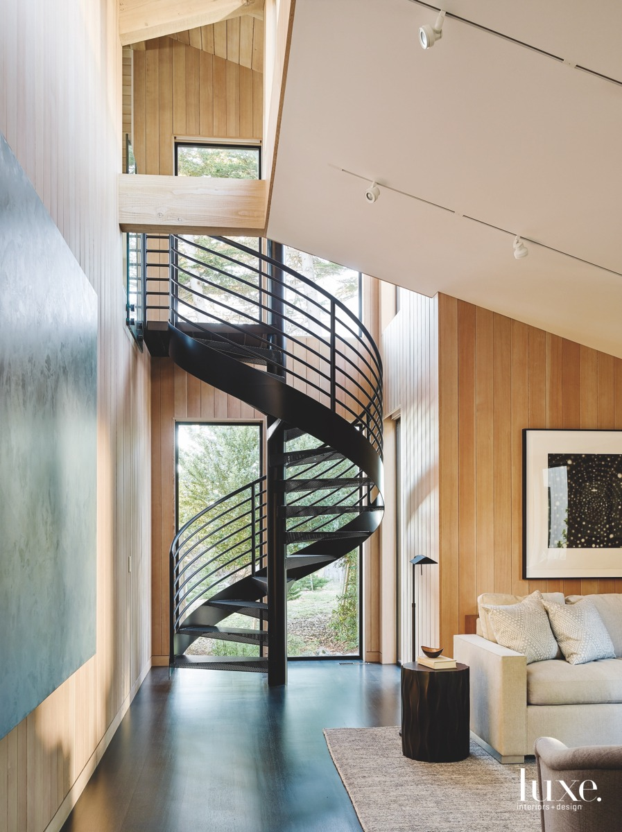 modern spiral staircase in spacious...