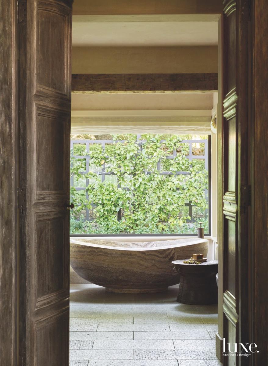 mediterranean bathroom freestanding travertine tub