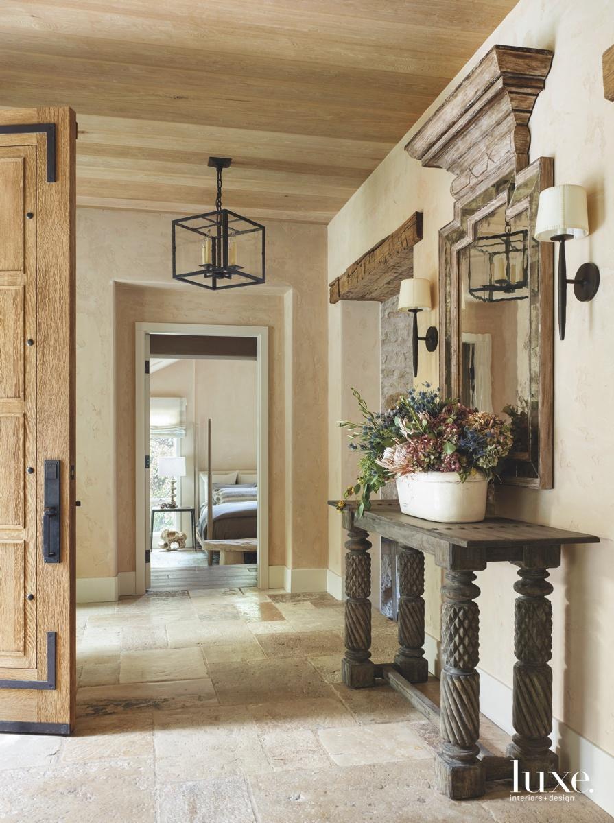 mediterranean entry foyer oak door...