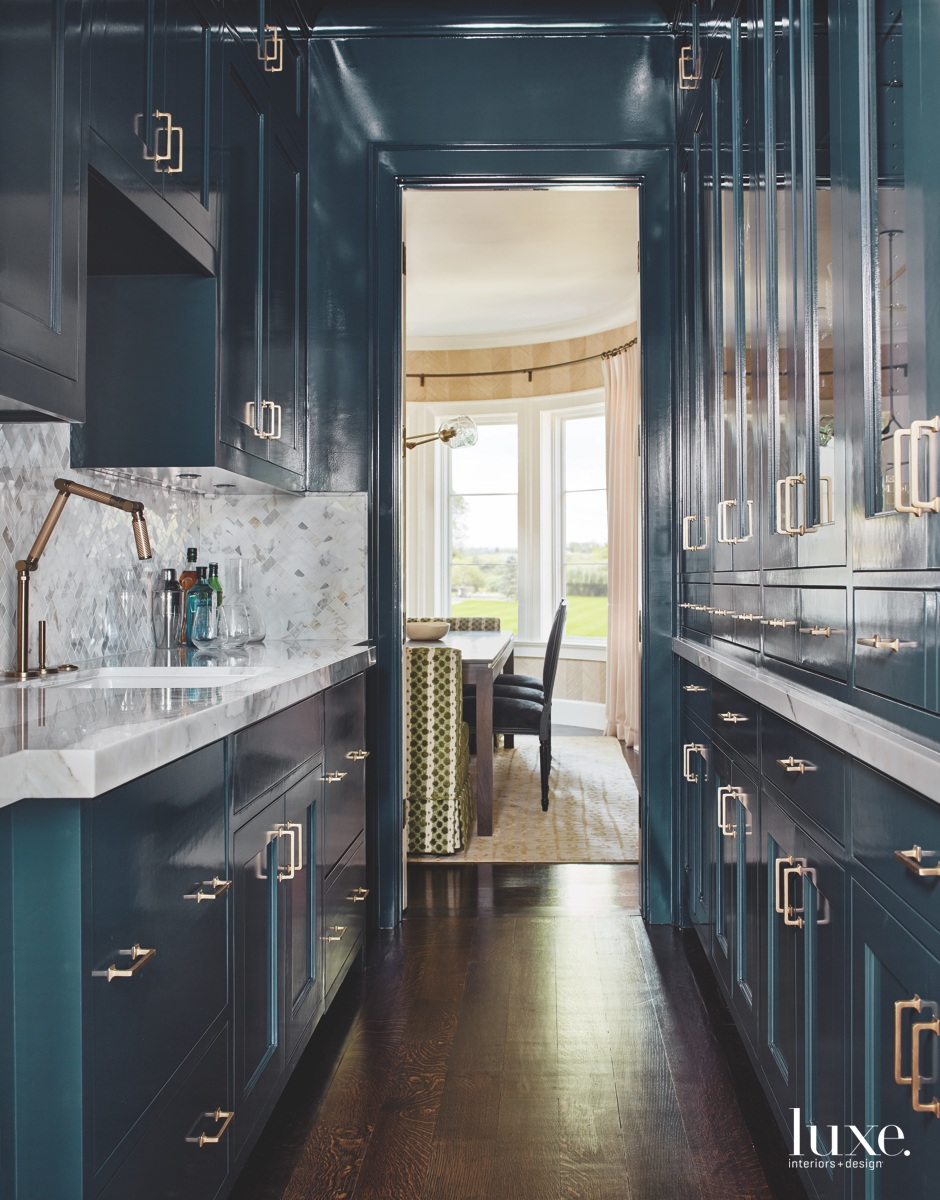 transitional kitchen blue cabinetry marble...