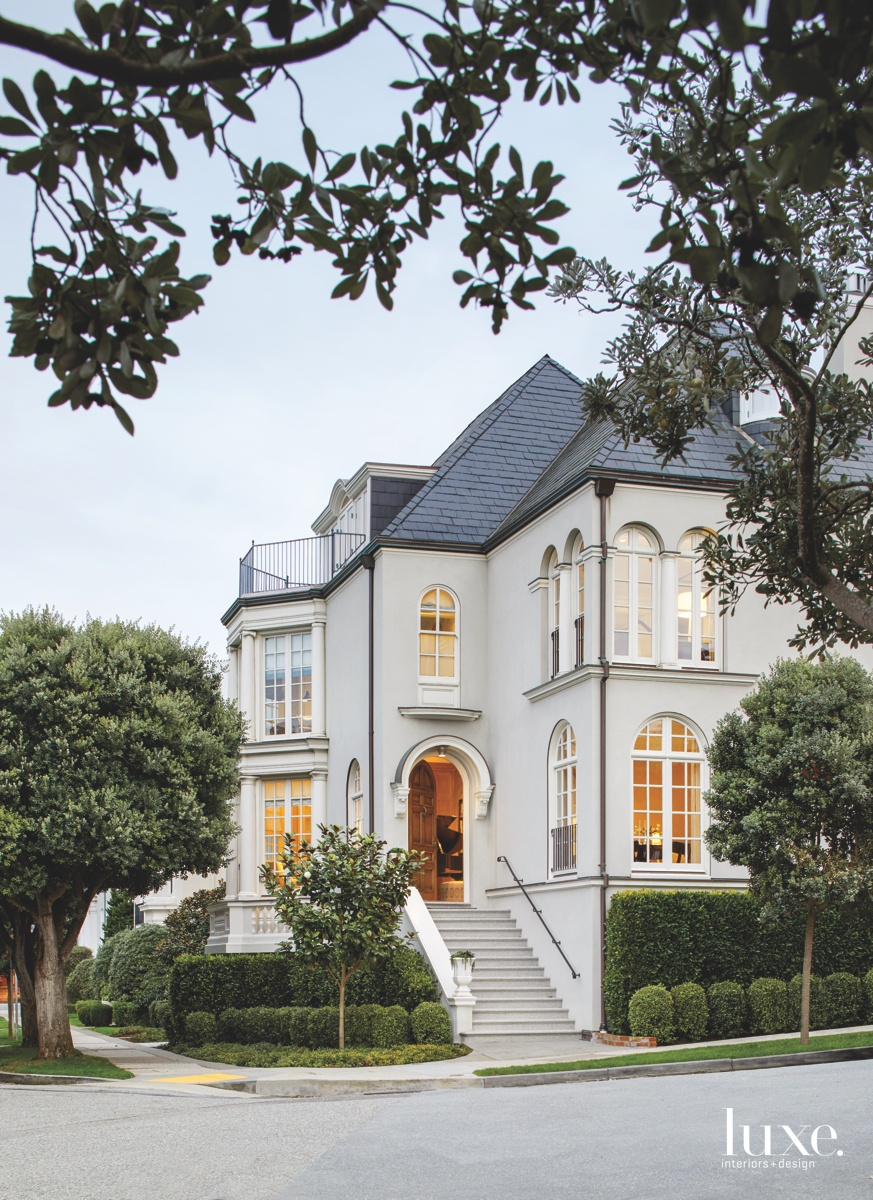 transitional white exterior golden gate