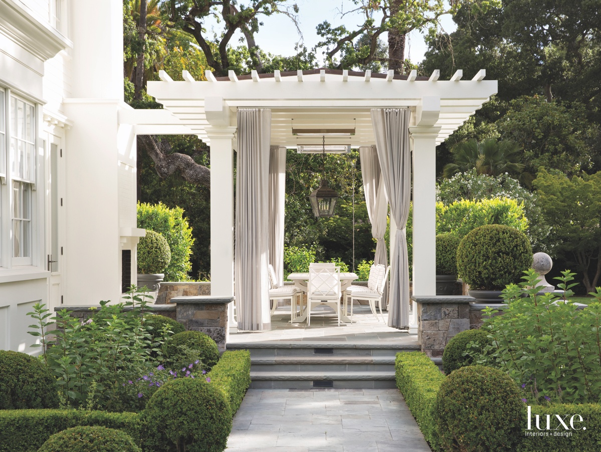 contemporary white outdoor dining sitting...