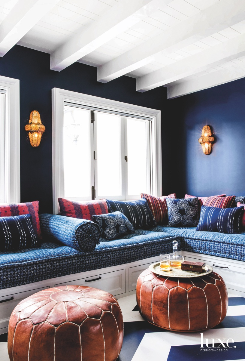 eclectic sitting area leather poufs blue built-in daybed