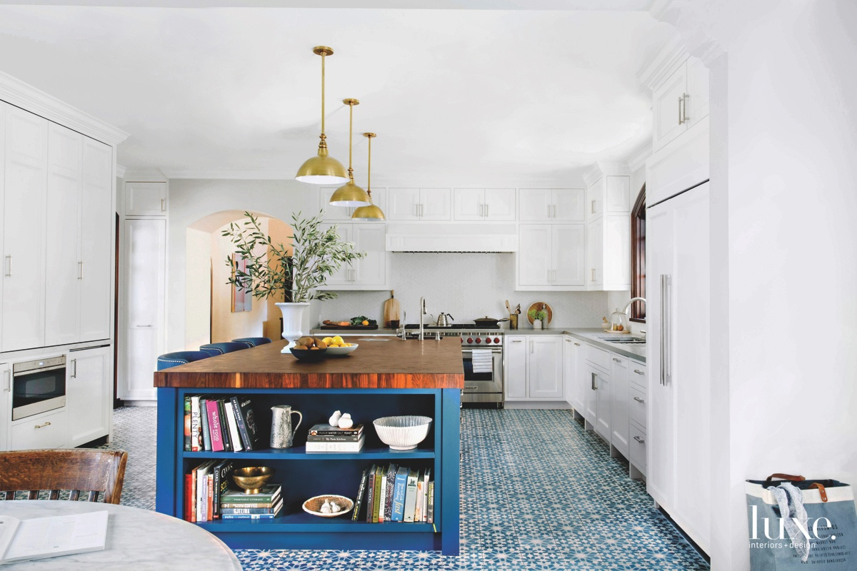 eclectic white kitchen blue island...