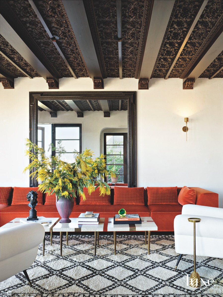 mediterranean living room red couch...
