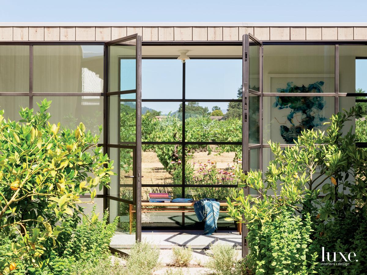 rustic glass breezeways steel-framed doors...
