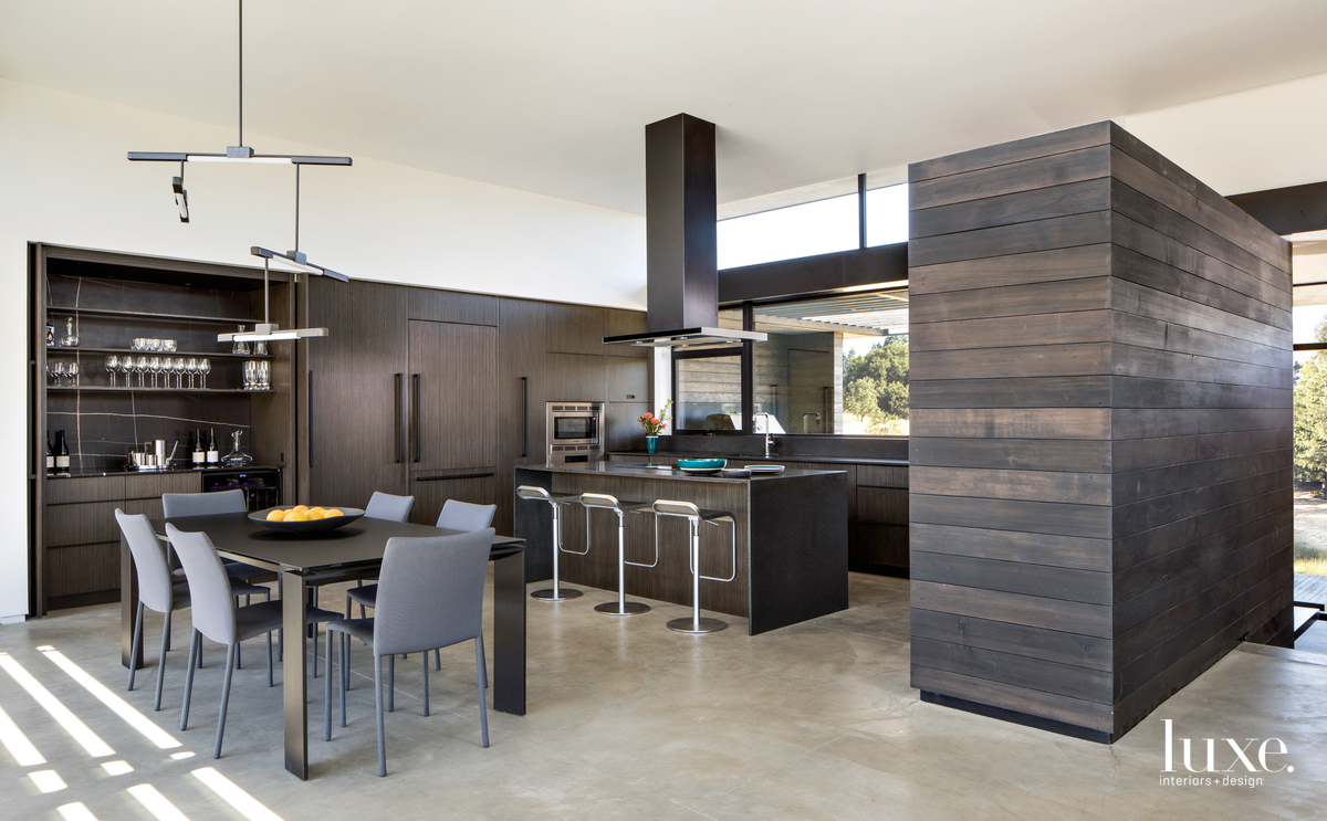 modern dark kitchen and dining...