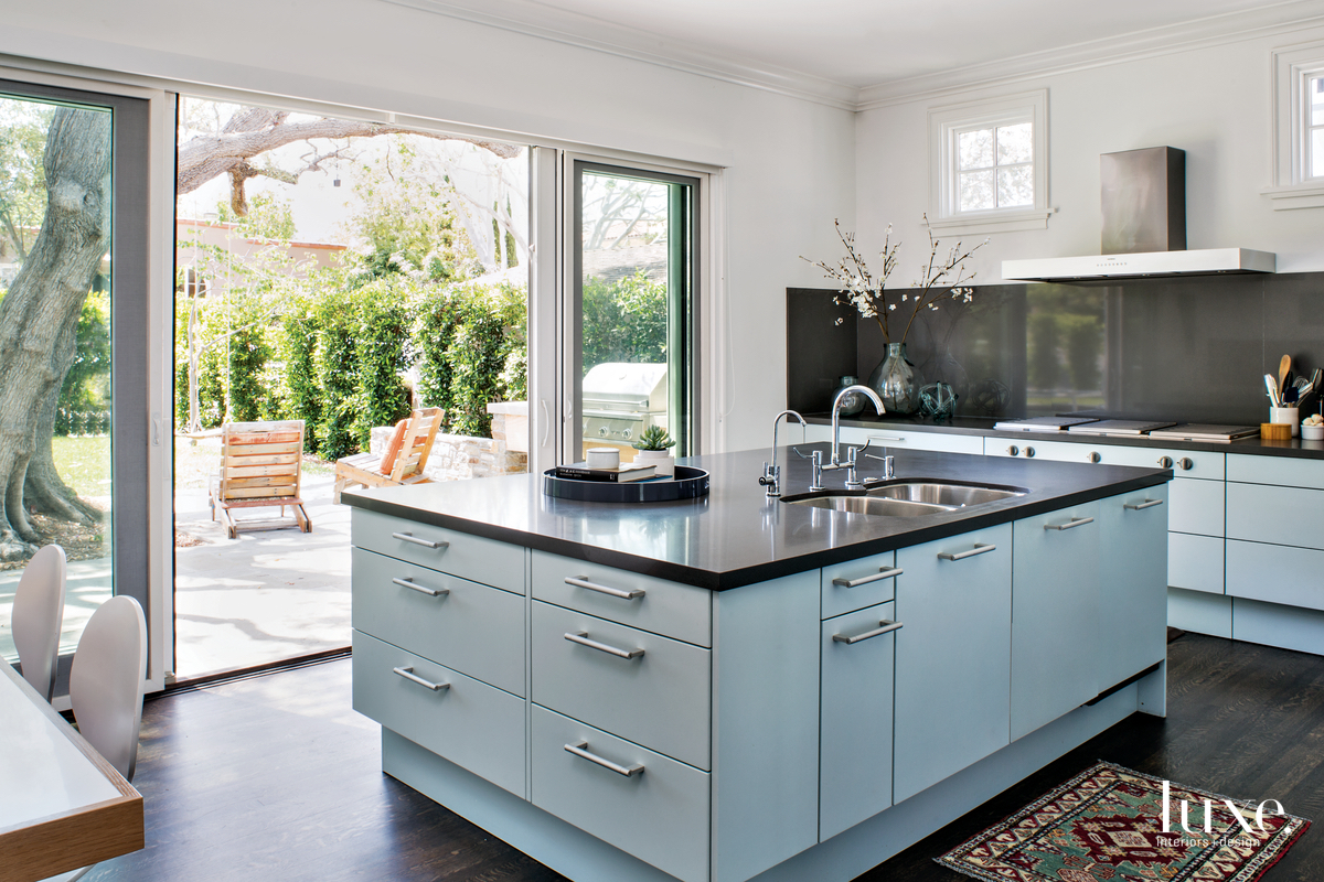 transitional kitchen pale blue cabinetry...