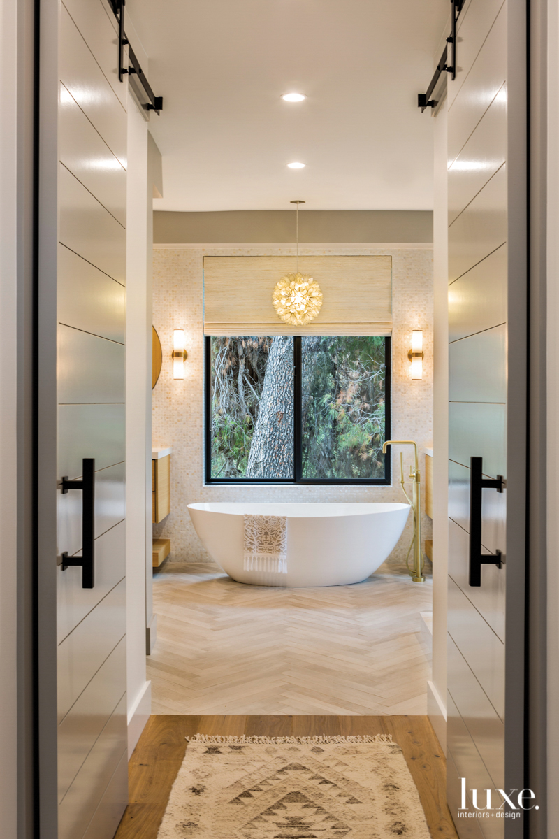 transitional neutral bathroom white tub