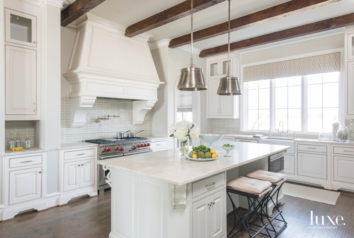 farmhouse white kitchen brown beam...