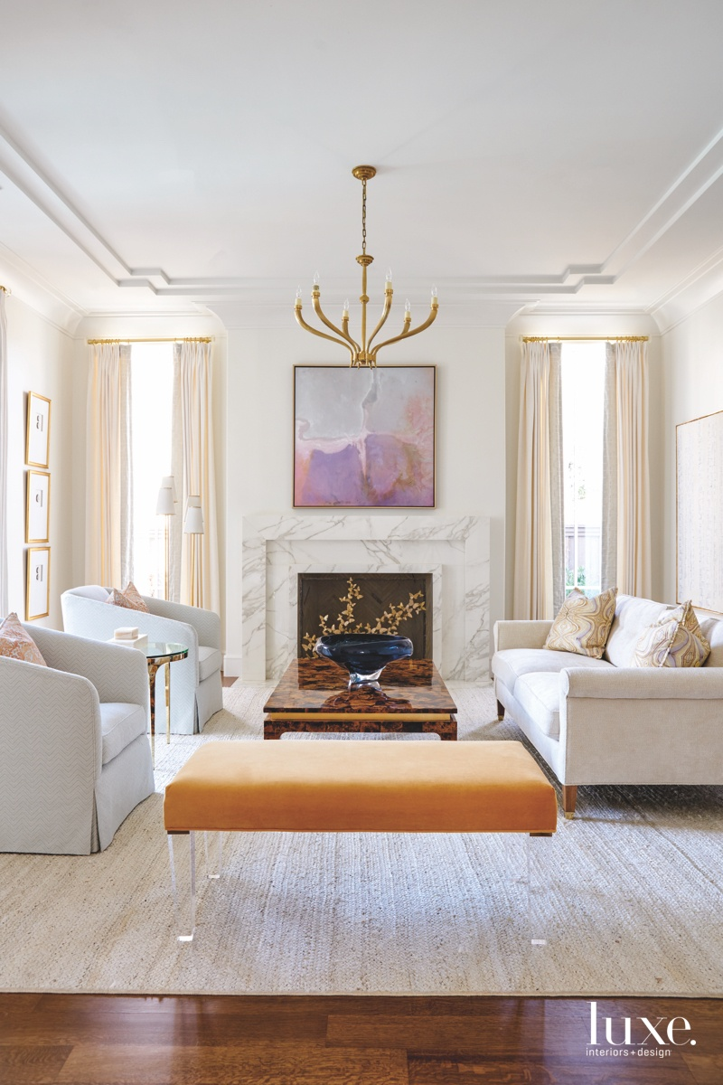 transitional living room marble fireplace...