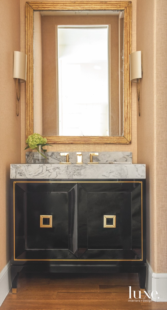 transitional powder room marble countertop...