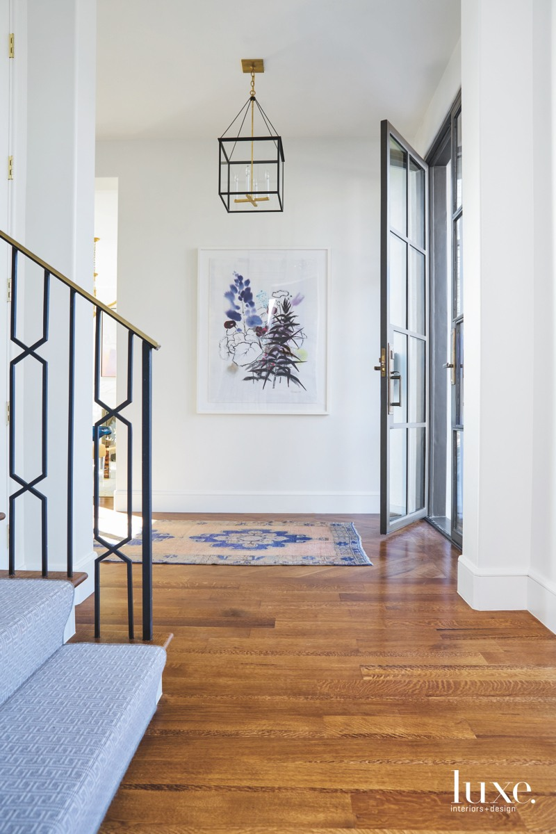 transitional entry stairs chandelier rug