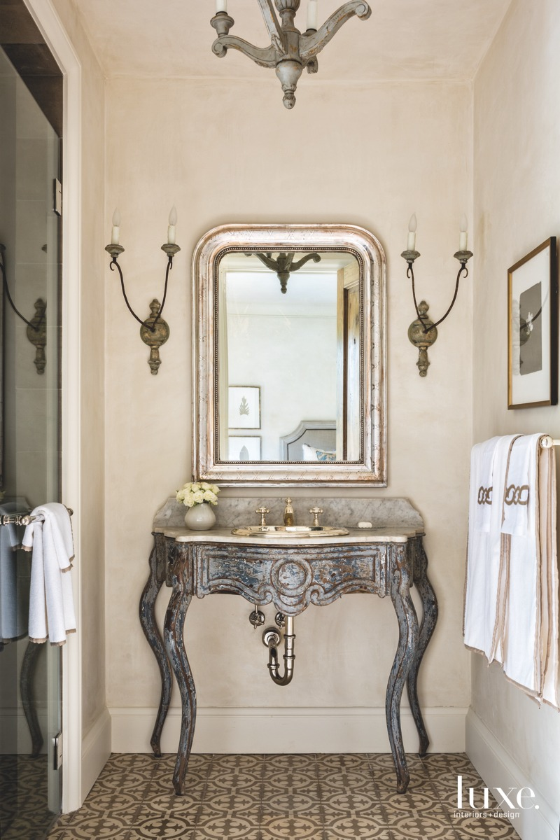 traditional mirror and sink in...