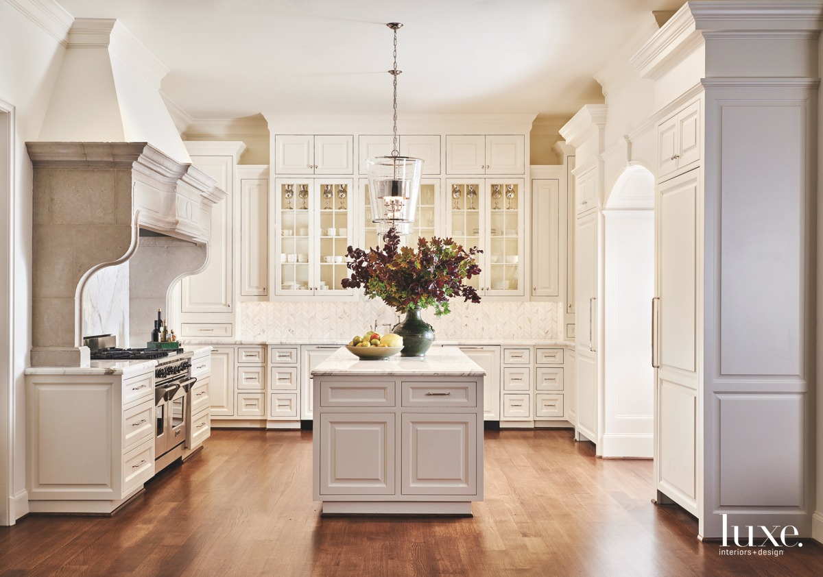traditional white kitchen white cabinetry...
