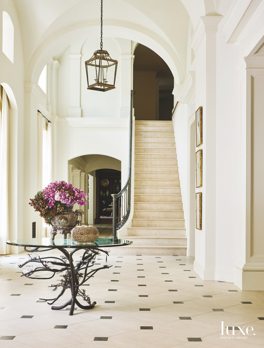 traditional foyer staircase limestone flooring