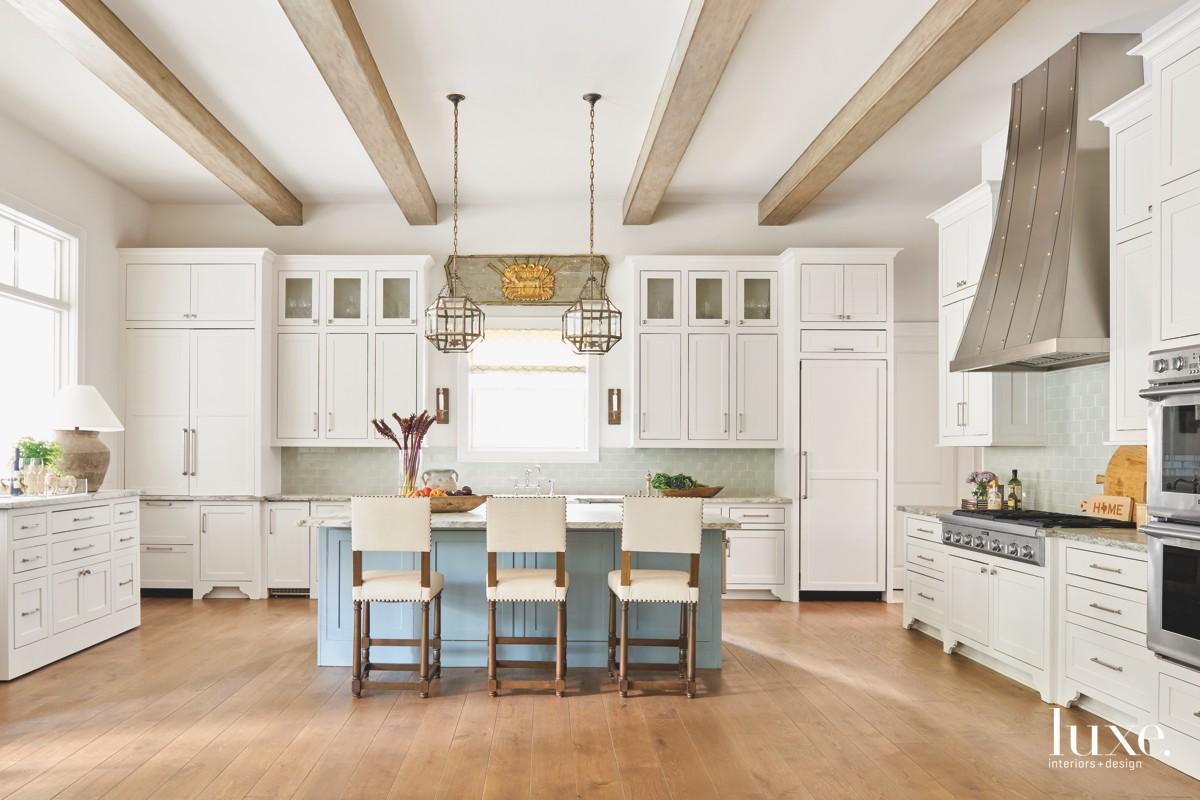 transitional white kitchen blue island