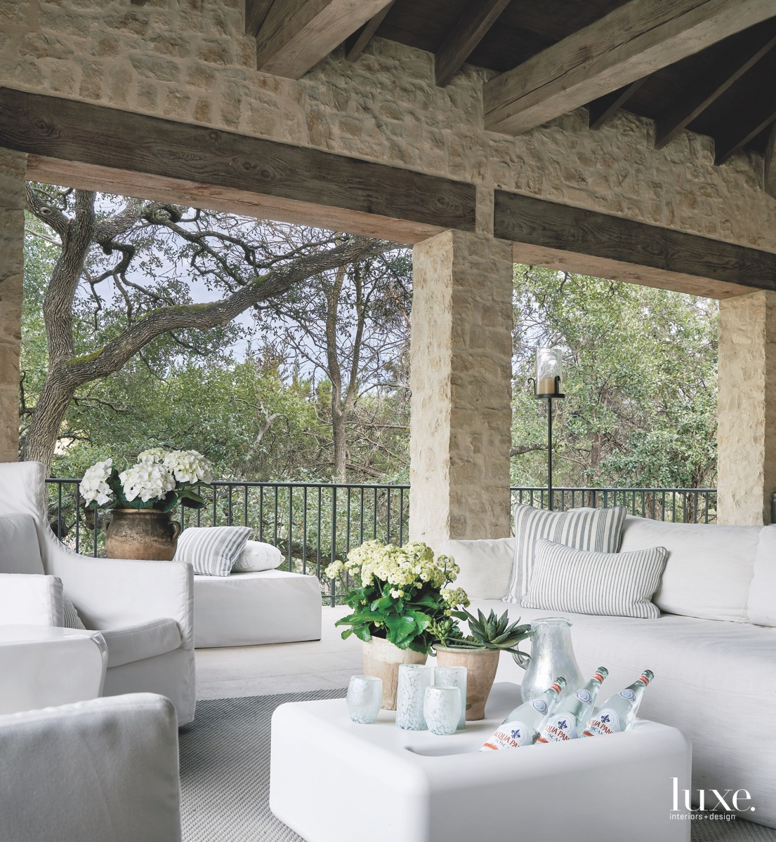 mediterranean outdoor sitting area white...