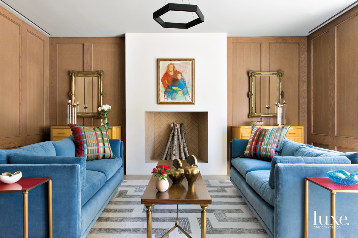 eclectic living room blue sofas...
