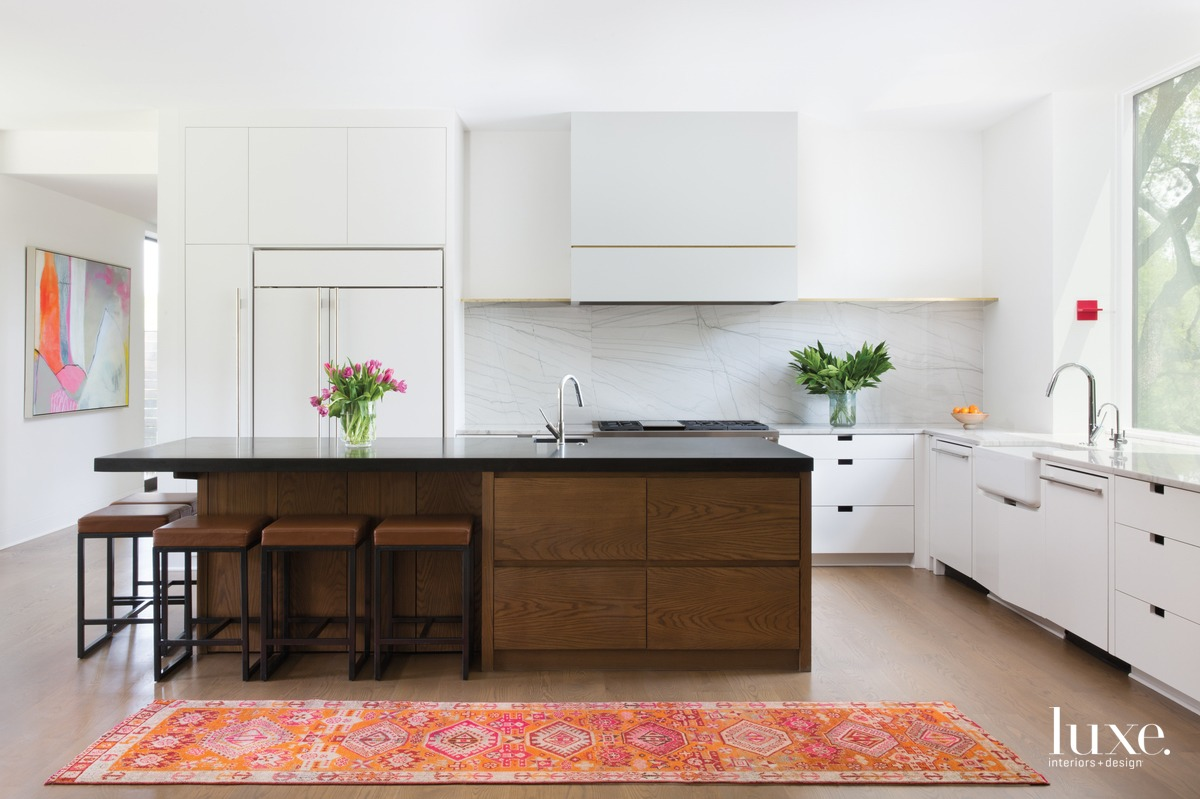 eclectic white kitchen brown island...