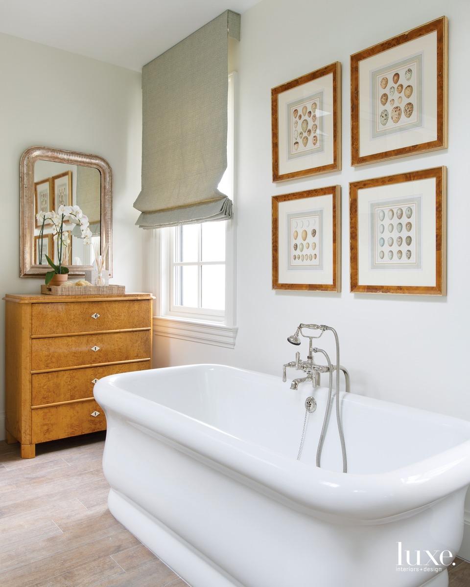 traditional bathroom white tub neutral...