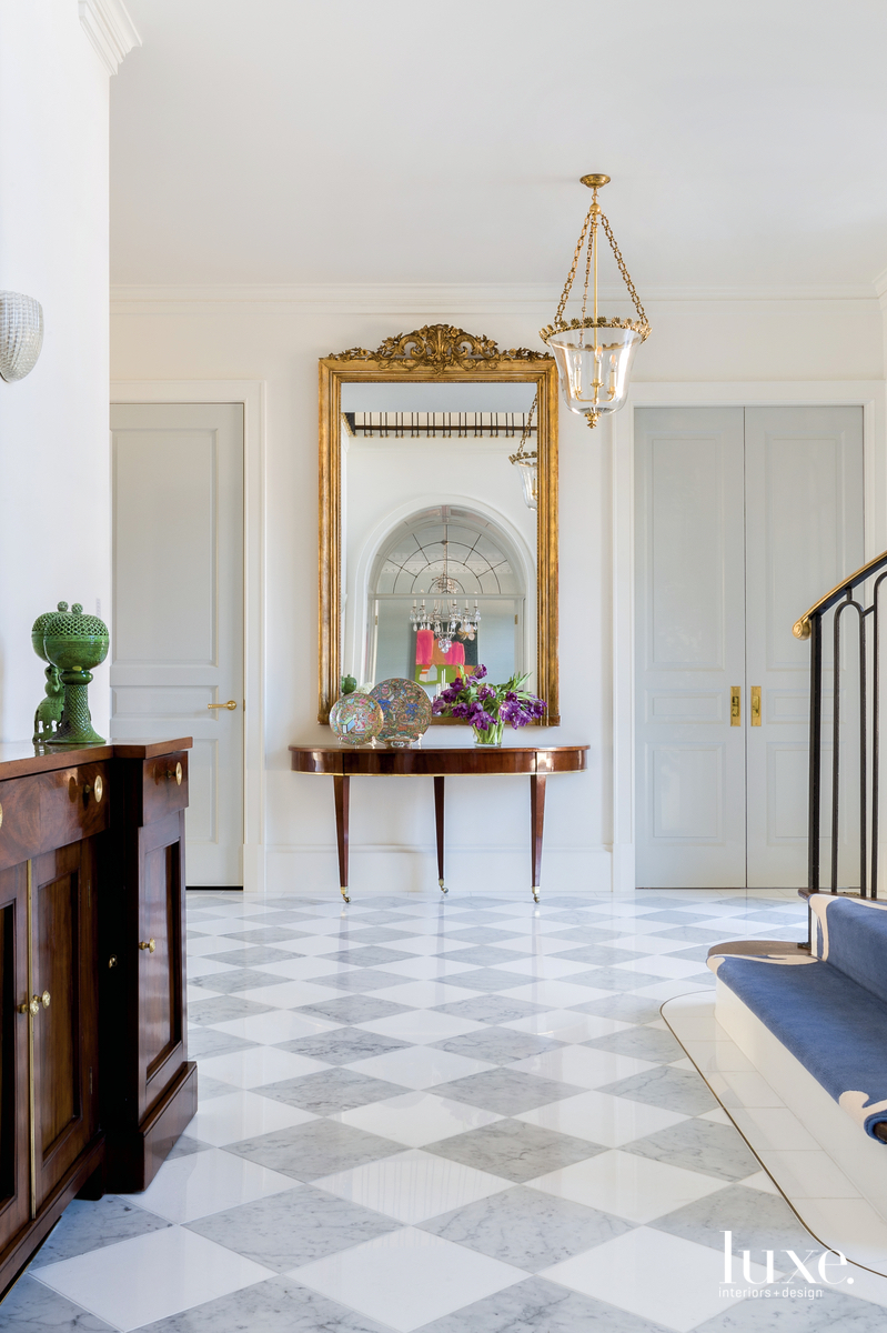 traditional foyer mirror gold accents...