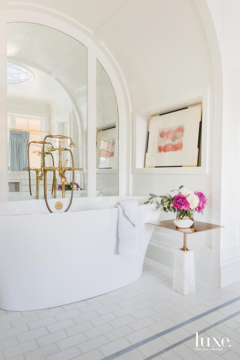 traditional white bathroom white tub...