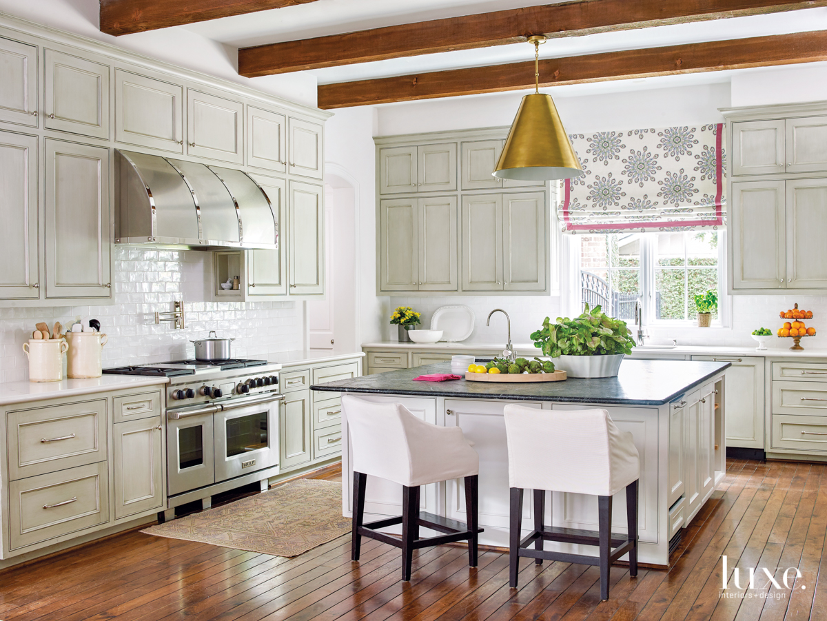 transitional kitchen neutral palette beamed...