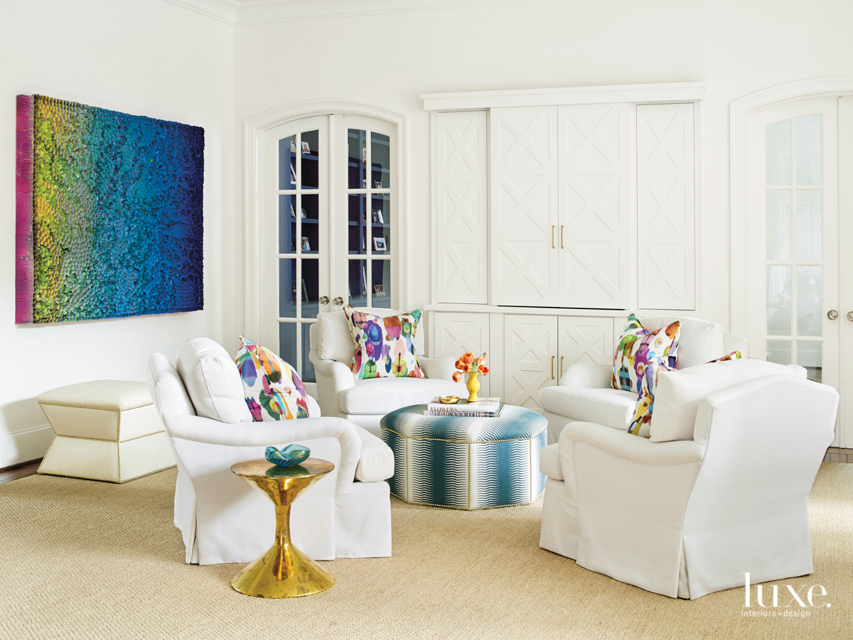 transitional white living room with...