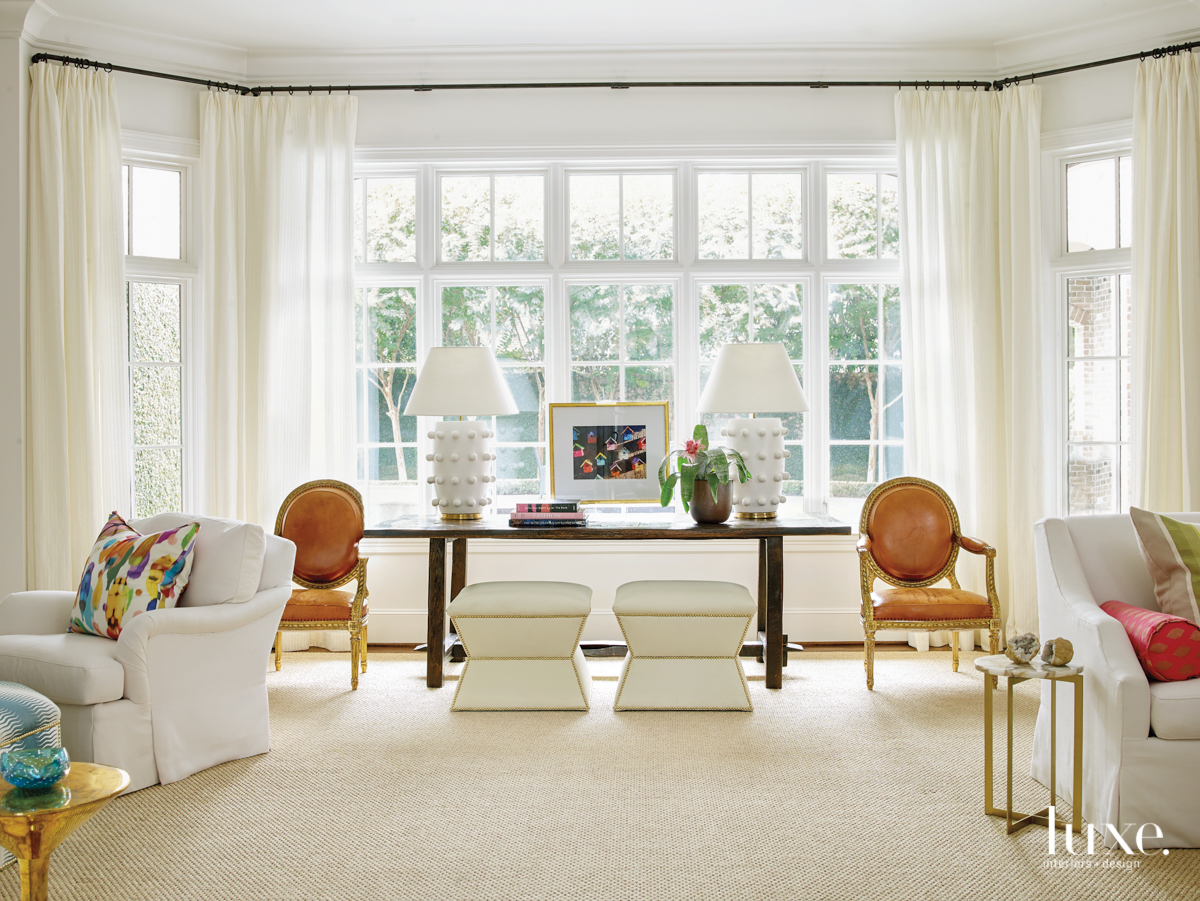 transitional living room white with...