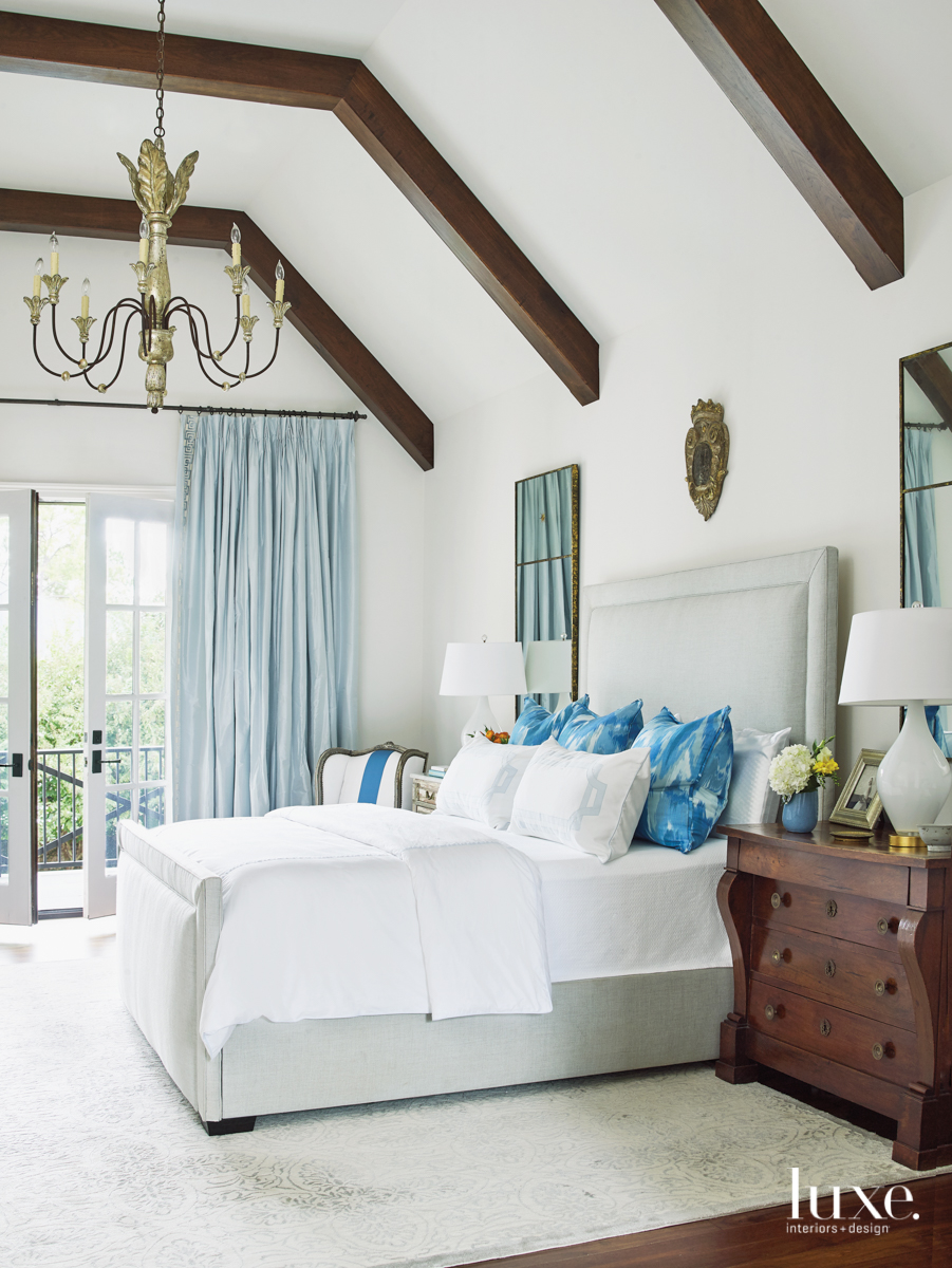 transitional white bedroom blue accents