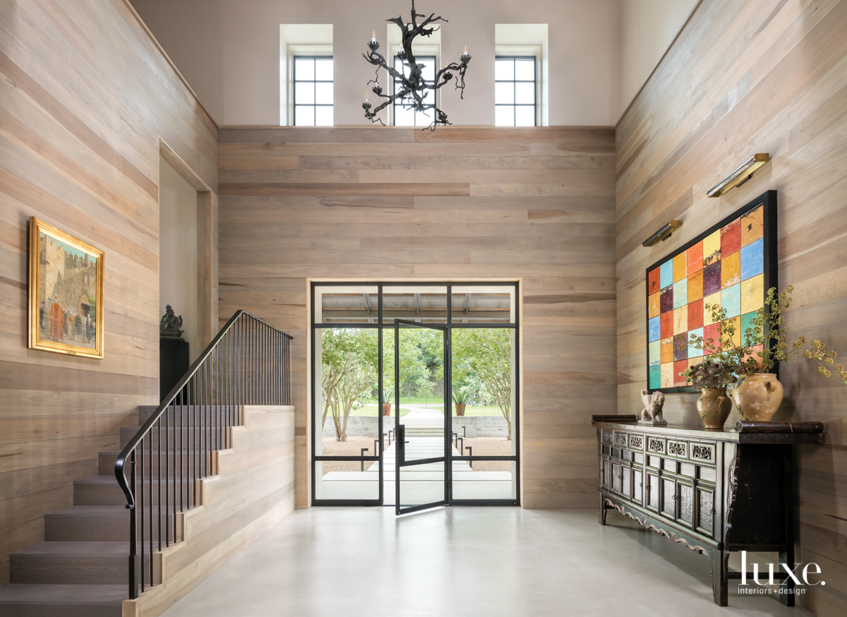 eclectic entry foyer neutral stairs