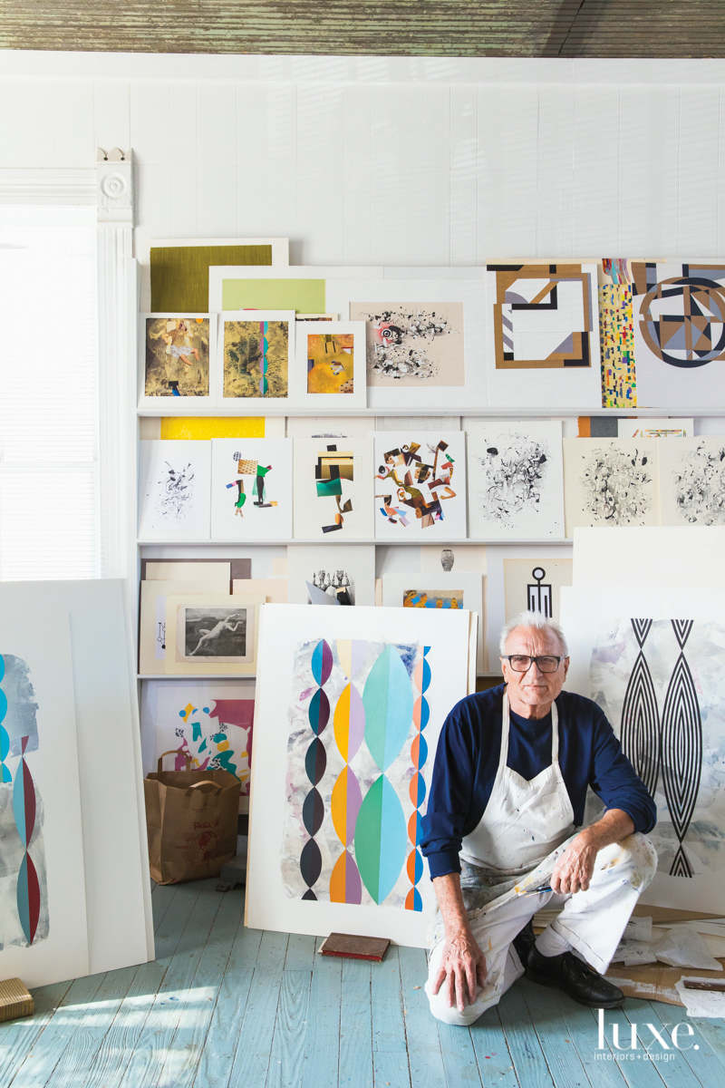 Austin-based artist Helmut Barnett kneels in his studio